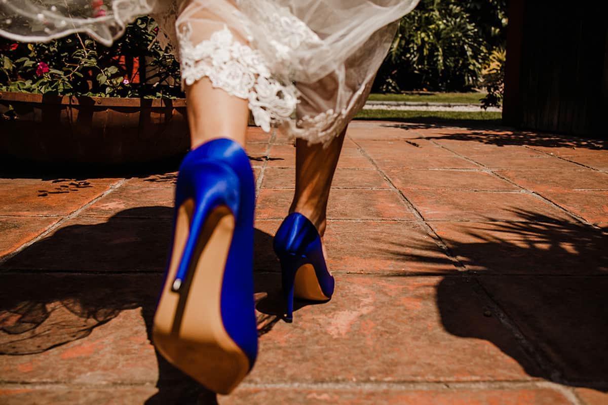 Bride Walking With Blue High Heel Shoes