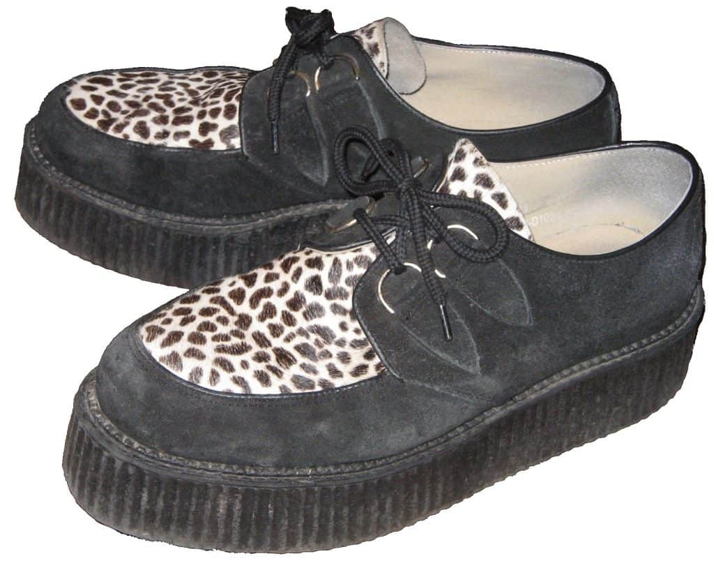 A pair of black suede brothel creepers with leopard print