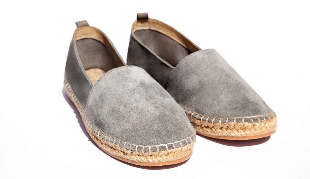 A pair of espadrille shoes with gray suede uppers